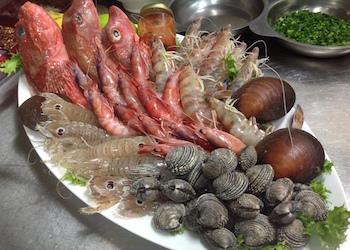 Pesce nel cenone, ok per tre  italiani su quattro, prezzi stabili